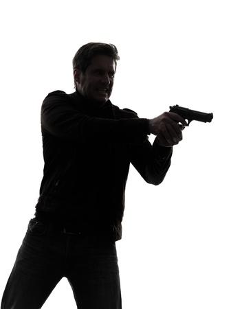 one man killer policeman aiming gun portrait silhouette studio white background