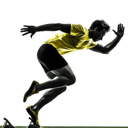 one caucasian man young sprinter runner  in starting blocks  silhouette studio  on white bac