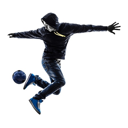 one caucasian young man soccer freestyler player  in silhouette  on white background