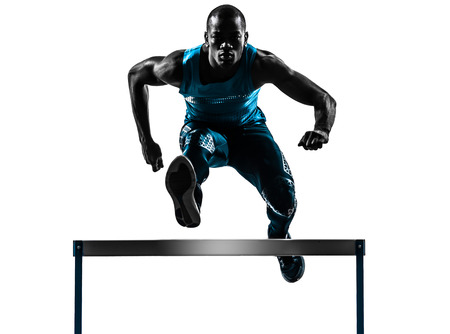 one african man hurdler running  in silhouette studio isolated on white background