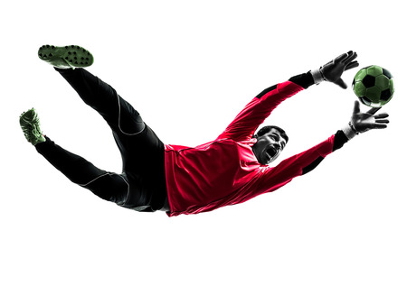 one caucasian soccer player goalkeeper man catching ball in silhouette isolated white background