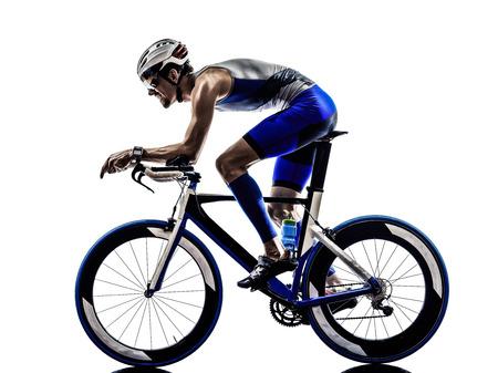 Photo pour man triathlon iron man athlete bikers cyclists bicycling biking  in silhouettes on white background - image libre de droit