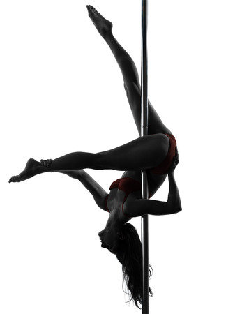 one  woman pole dancer dancing in silhouette studio isolated on white background