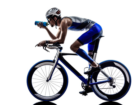 Photo pour man triathlon iron man athlete biker cyclist bicycling biking drinking in silhouette on white background - image libre de droit