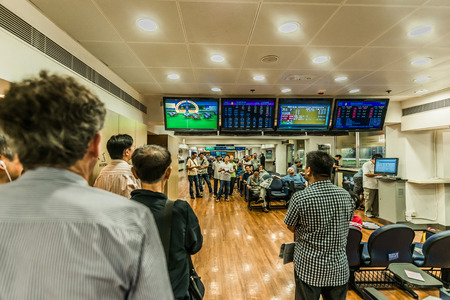 Happy Valley, Hong Kong, China- June 5, 2014: people betting horse races at Happy Valley racecourse