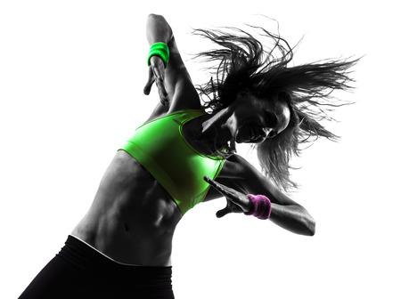 Foto de one  woman exercising fitness zumba dancing in silhouette on white  - Imagen libre de derechos
