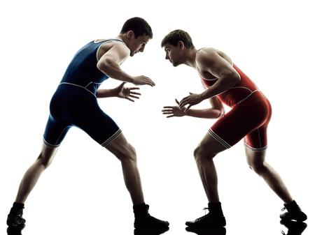 Photo pour two caucasian wrestlers wrestling men on isolated silhouette white background - image libre de droit
