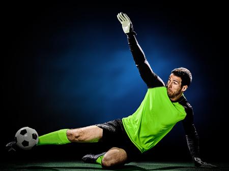 Photo pour one caucasian goalkeeper soccer man isolated on black background - image libre de droit