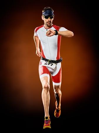 Photo pour one caucasian  man runner running  triathlon ironman isolated - image libre de droit