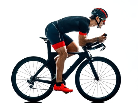 Photo pour triathlete triathlon Cyclist cycling  in studio silhouette shadow  isolated  on white background - image libre de droit