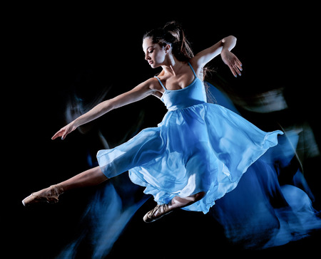 Photo for one caucasian young woman ballet dancer dancing isolated on black background with  light painting motion blur speed effect - Royalty Free Image