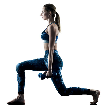 Photo pour one caucasian woman exercising fitness weights excercises in silhouette isolated on white background - image libre de droit