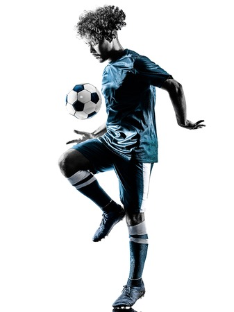 Photo pour one mixed race young teenager soccer player man playing  in silhouette isolated on white background - image libre de droit