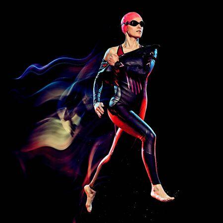 Photo pour one caucasian woman triathlon triathlete studio shot isolated on black background with light painting effect - image libre de droit