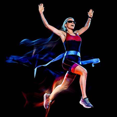 Foto de one caucasian woman triathlon triathlete runner running joogger jogging studio shot isolated on black background with light painting effect - Imagen libre de derechos