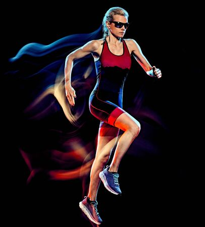 Photo pour woman triathlon triathlete runner running joogger jogging isolated black background - image libre de droit