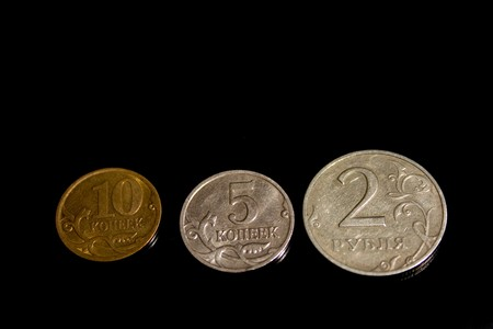 Ruble, penny, coin, three on a black background