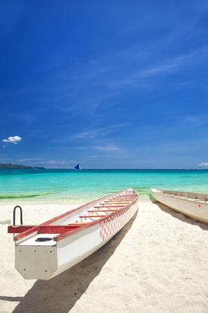 Boats On Sandy Beach