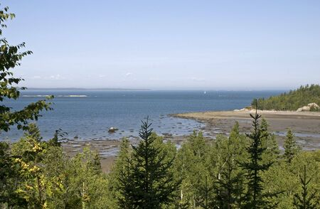 St. Lawrence River shore at low tide in Le Bic, Quebec, Canada