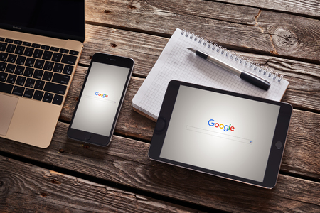 Photo for PRAGUE, CZECH REPUBLIC - SEPTEMBER 1, 2015: New Google logo on their search page immediately at the release date is displayed on iphone 6 plus and ipad mini. - Royalty Free Image