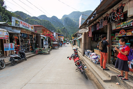 El Nido, Palawan - January 16, 2015: main street of El Nido in Palawan, one of the main islands in the Philippines. Local people on foreground.