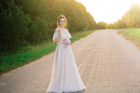 Photo pour Young happy exited beautiful woman in blooming garden. Bride. - image libre de droit