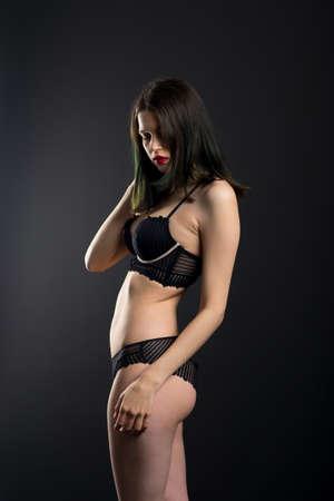 Photo for Vertical view photo beautiful shy lady in a lace bikini boudoir bra panties. - Royalty Free Image