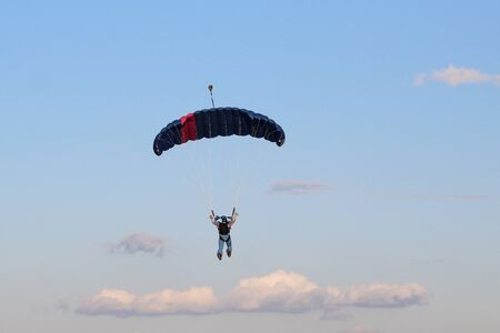 PARATROOPER IN THE SKY WITH CLOUDS