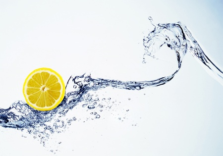 lemon in spray of water