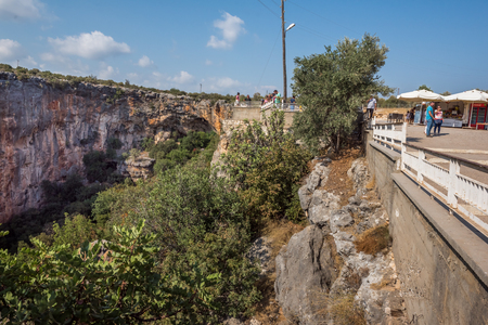 Unidentified people looking at Chasm of Heaven located in Silifke district, Mersin Turkey.29 August 2017.