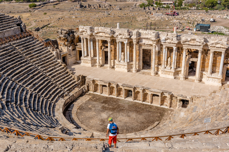 People visit The ruins of Antique Theater in ancient Greek city Hierapolis, Pamukkale, Turkey.25 August 2017