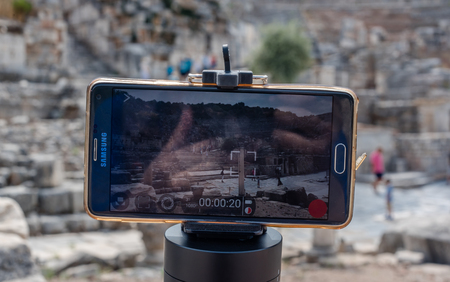 Cell,mobile phone takes photo of ancient ruins at Ephesus historical ancient city, in Selcuk,Izmir,Turkey:20 August 2017