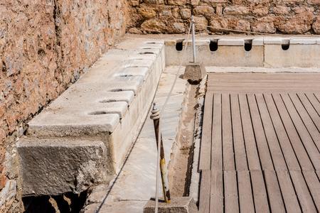 Public Toilets,Latrines, Ruins in Ephesus historical ancient city, in Selcuk,Izmir,Turkey.