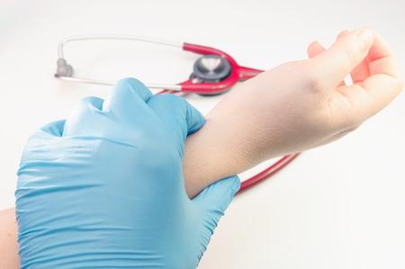 doctor hand taking radial artery pulse