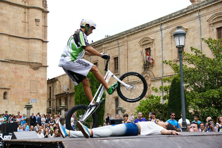 SALAMANCA, SPAIN - SEPTEMBER 8: bmx bicycle exhibition in Cathedral Square on September 8, 2012 in Salamanca, Spain. It was declared a UNESCO World Heritage Site in 1988.