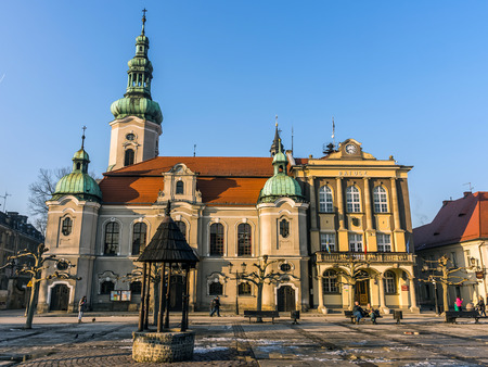Pszczyna, Poland - February 14, 2015: Lutheran church and town hall in the main square. City was founded 1303 and Lutheranism was introduced to Pszczyna in 1568 by Duke Karol Promnitz.