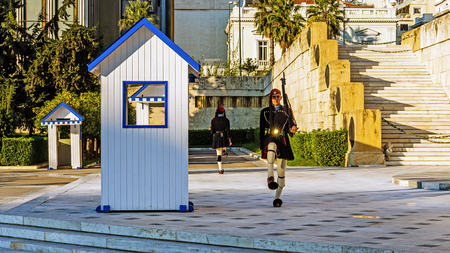 ATHENS, GREECE - NOVEMBER 6, 2015: Changing of the guards at the Greek Tomb of the Unknown Soldier. The guard is held by The Evezones, a ceremonial traditionally uniformed unit of The Presidential Guard.