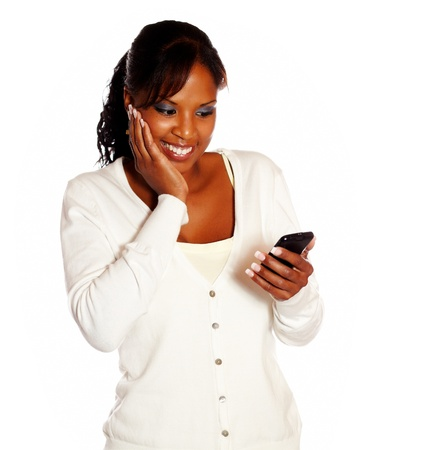 Adult woman sending message on mobile phone on isolated background