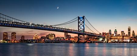 Philadelphia skyline and Benjamin Franklin Bridge at dusk as seen from Camden, New Jersey