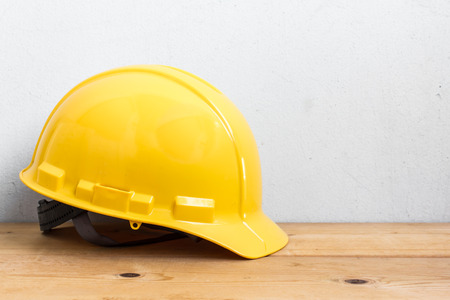 Photo for Helmet Safety On Wood Table - Royalty Free Image
