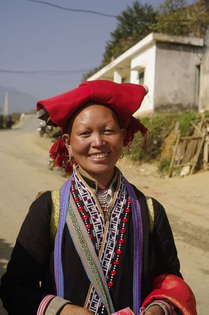 Ethnic Hmong woman red pompoms