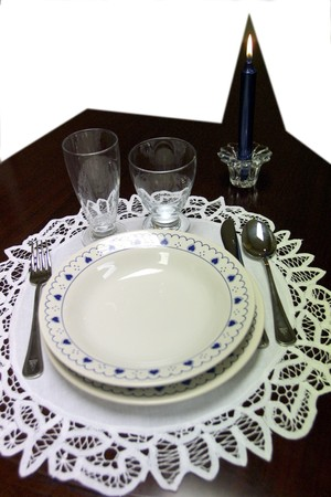 Table prepared with utensils and dishes ready to eat