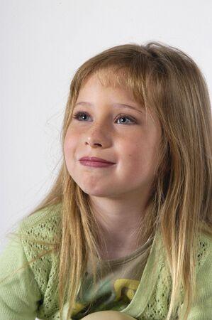 Blond girl in photo studio