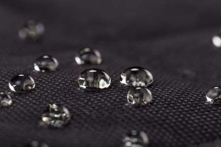 Photo for Water drops on waterproof black fabric. Macro photography. - Royalty Free Image