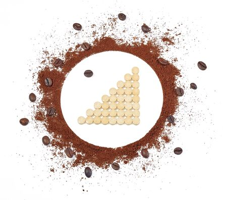 Photo pour Tablets laid out in the form of a graph of positive growth inside the circle of ground coffee and coffee beans, isolated on a white background. Isolated. - image libre de droit