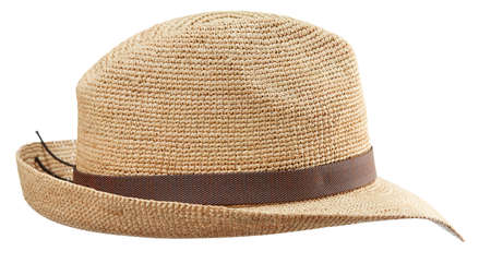 Photo pour Beautiful wide-brimmed wicker hat fedora woven from straw, isolated on a white background. Handmade work. - image libre de droit