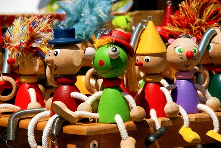 Close up of handmade colorfull wooden puppets