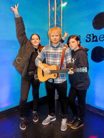 BLACKPOOL, JANUARY 14: Madame Tussauds, UK 2018. Edward Christopher Sheeran and two posing girls.
