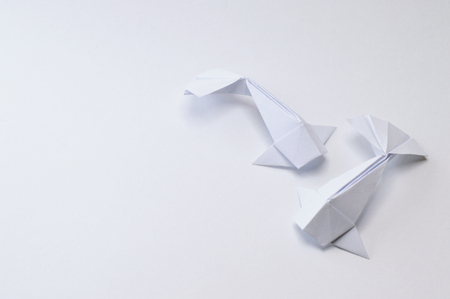 Foto de Origami figure paper in white background - Imagen libre de derechos