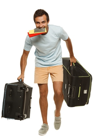Young male tourist hurrying to the flight holding tickets with passport in his teeth, isolated on white background